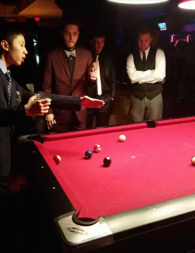 Ryan Do (left) and Nick DeSimone (right) enjoy a game of pool. Photo courtesy of Jefferson Kadhelaj.