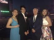Jana Pugsley (277), Nicholas Romano (277), Mr. Humes, and Jamie Razler (277) pose in front of the diamond.