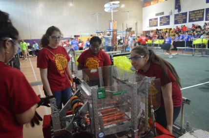 Members of the Robolancers inspect their robot. PC: Ernesto Estremera