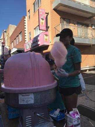 Annie Yang (278) makes cotton candy.