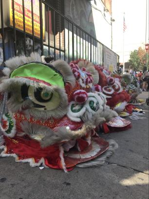 Lion dancer costumes set out for display in preparation for the dance.
